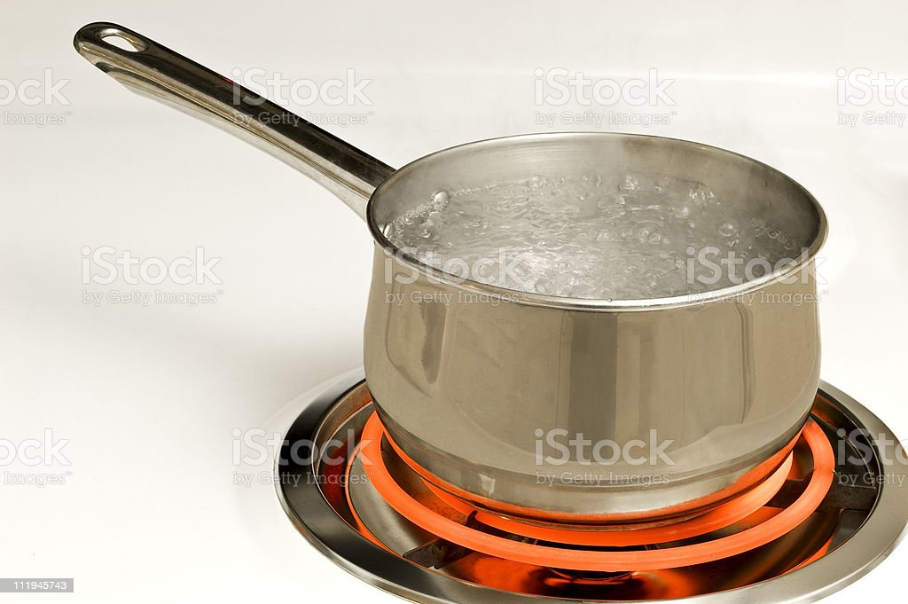 Pan Of Boiling Water On Hot Burner royalty-free stock photo