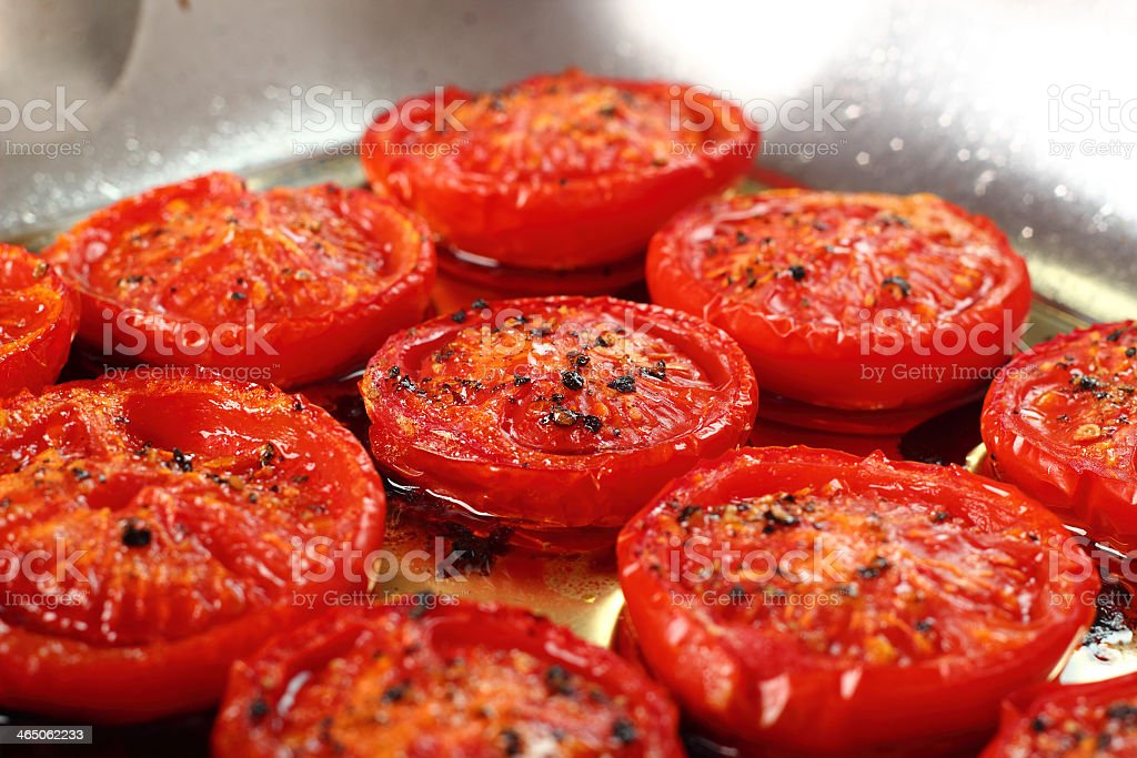 A pan of slow roasted tomatoes stock photo