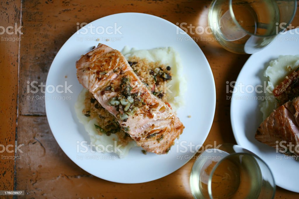 Pan roasted salmon with quinoa and mashed potatoes royalty-free stock photo