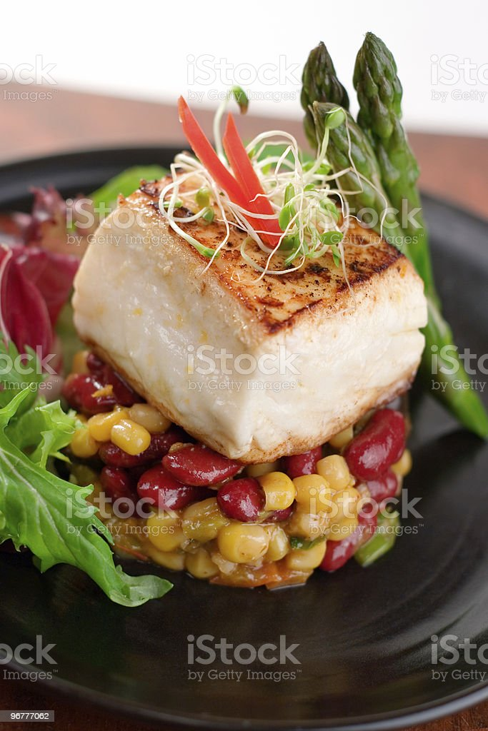 Pan seared halibut on a bed of beans royalty-free stock photo