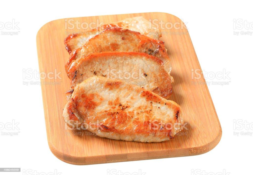 Pan seared pork cutlets stock photo