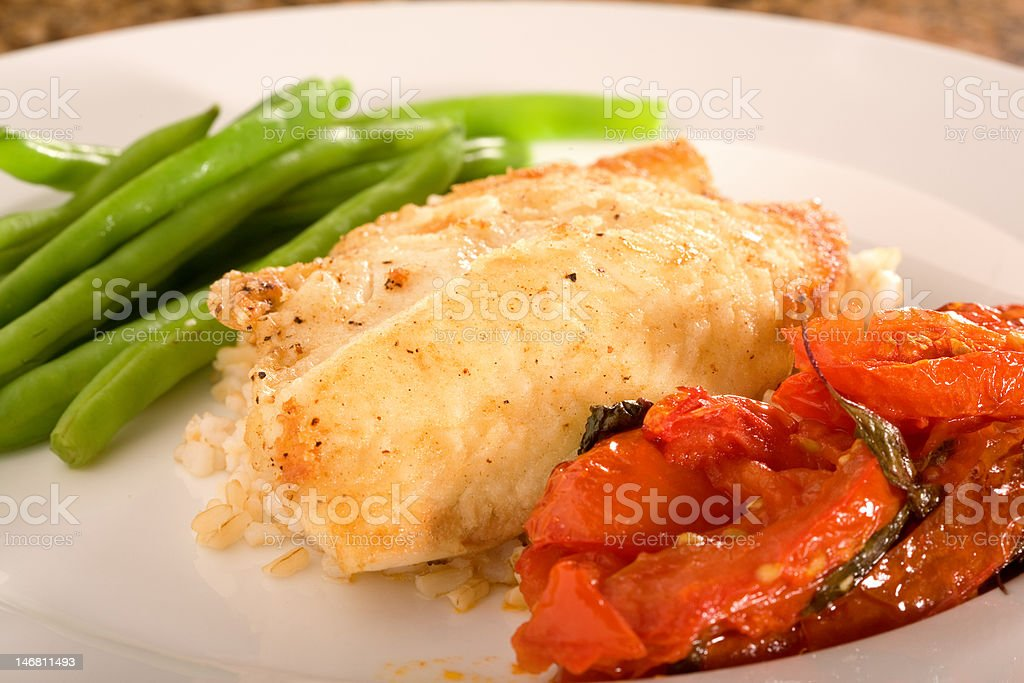 Pan Seared Tilapia and tomatoes royalty-free stock photo