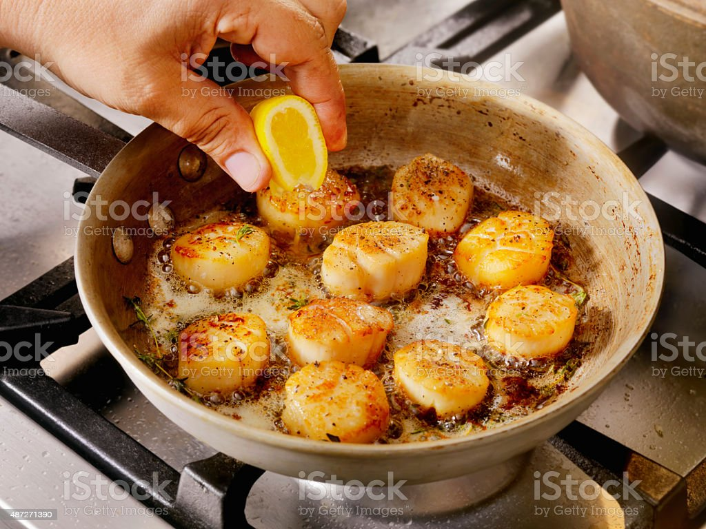 Pan Searing Scallops in Butter stock photo