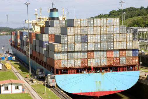 container ship passing through the locks an panama cnal