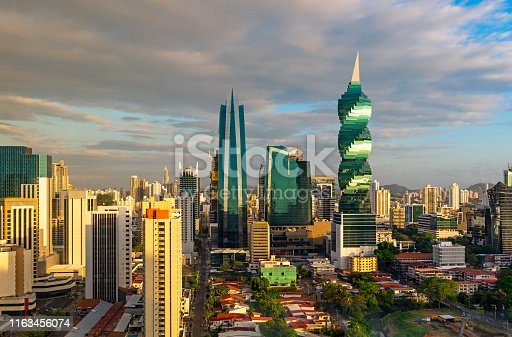 The modern urban skyline of Panama City with futuristic skyscrapers at sunrise, Panama, Central America.