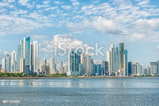 Panorama of Panama city, high buildings against blue sky, in front blue sea. Panama
