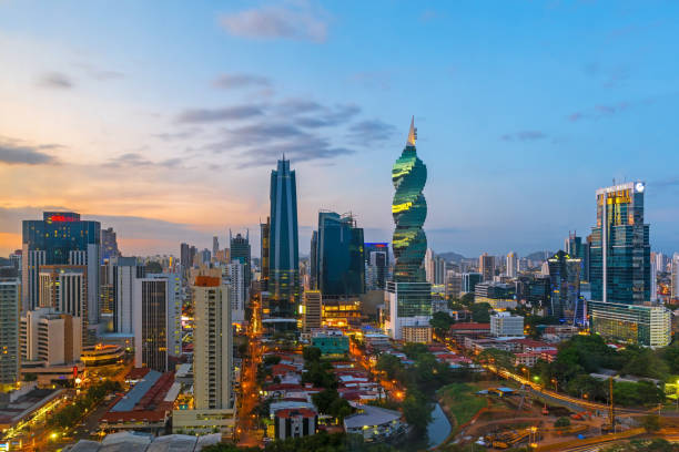 Panama City Skyline The colorful urban skyline of Panama city with a view over the financial district at sunset, Panama, Central America. central america stock pictures, royalty-free photos & images