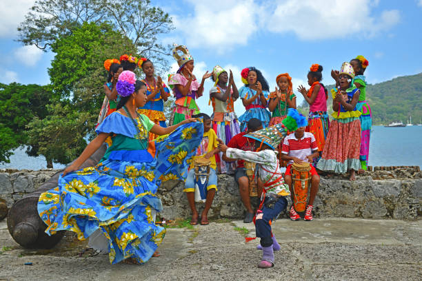 Panama Congo Dance in Portobelo A group of young Panamenians performing the Congo dance in one of the Spanish fortresses (hence the cannons) of Portobelo by the Caribbean Sea, Panama, Central America. central america stock pictures, royalty-free photos & images