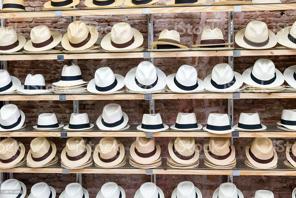 Panama hats displayed on shelves stock photo