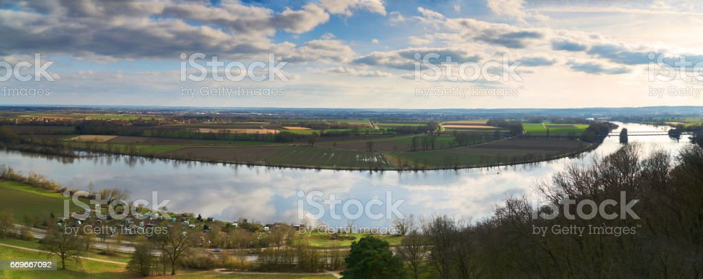 Panaroma at the walhalla with the view to the danube valley in early spring. Reflection from the clouded sky in the river. stock photo