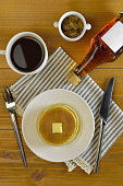 pancake and a cup of coffee on the table/top angle