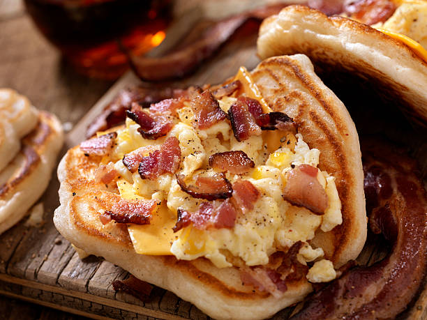 Pancake Breakfast Taco with Scrambled Eggs, Bacon and Cheese stock photo