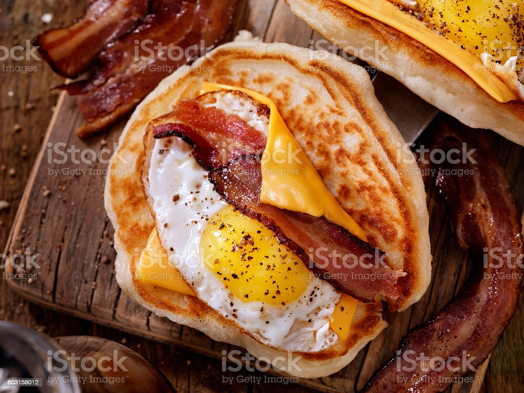 Pancake Breakfast Taco with Suny side up Eggs, Bacon, Cheese stock photo