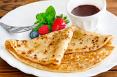 French pancake and chocolate sauce background