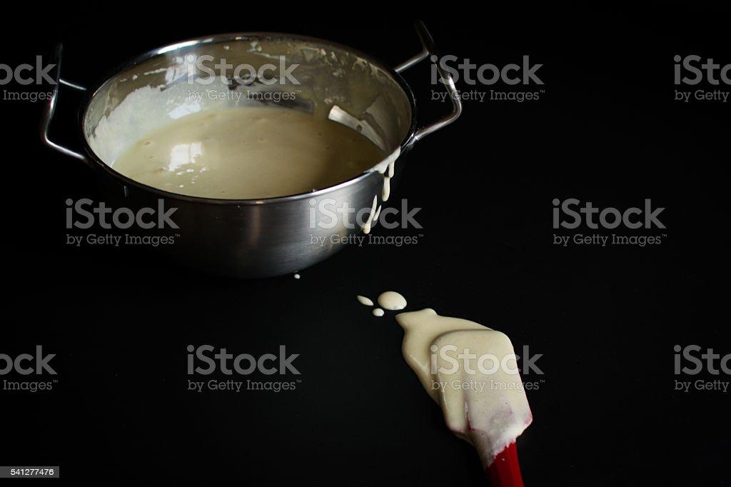 Pancake Dough In silver bowl on black stock photo
