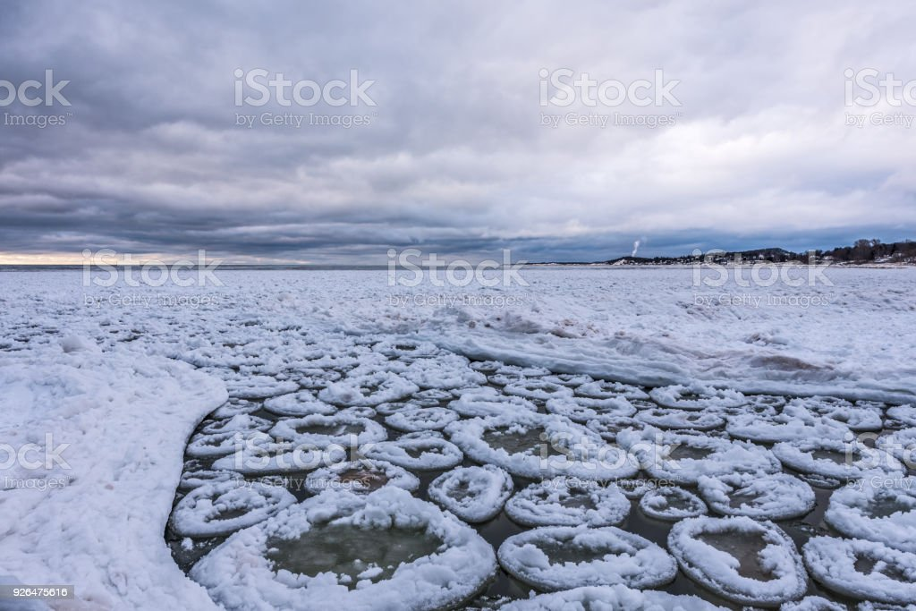 Pancake Ice Floating on Lake Michigan stock photo