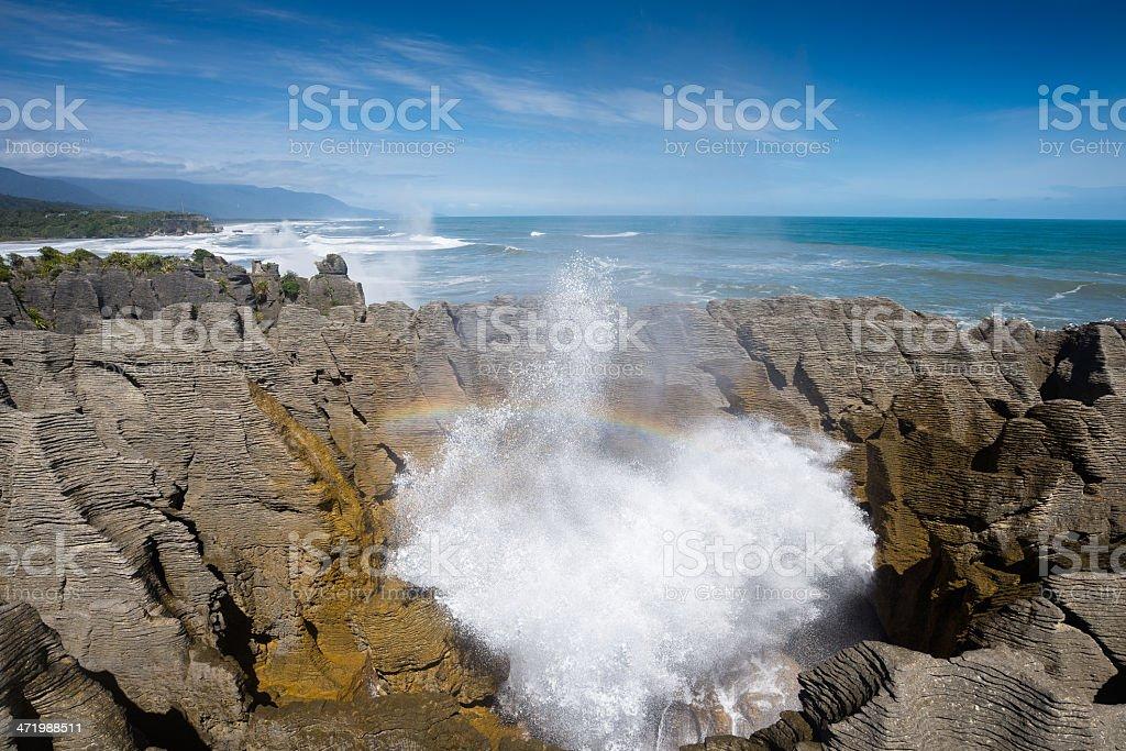 Pancake rock burst water and rainbow, Punakaiki, New Zealand stock photo