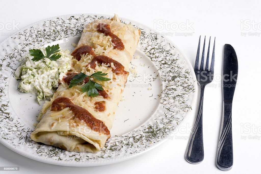 Pancake / tortilla / burrito on plate royalty free stockfoto