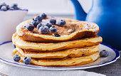 Pancake with banana , blueberries and honey.