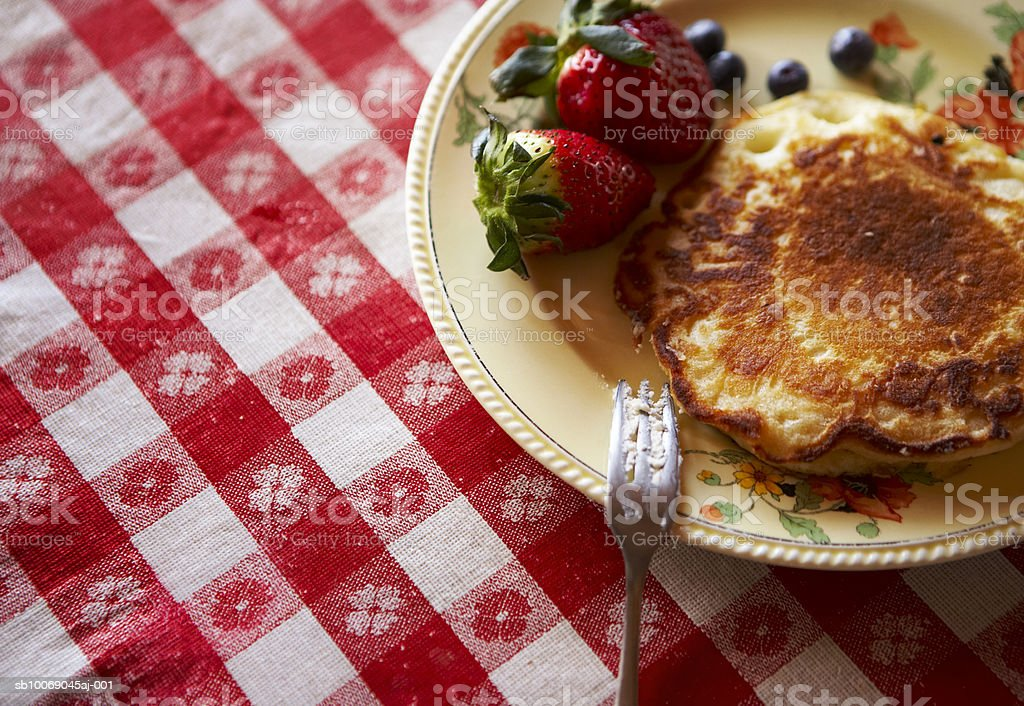 Pancake with blueberries and strawberries, close-up royalty-free stock photo