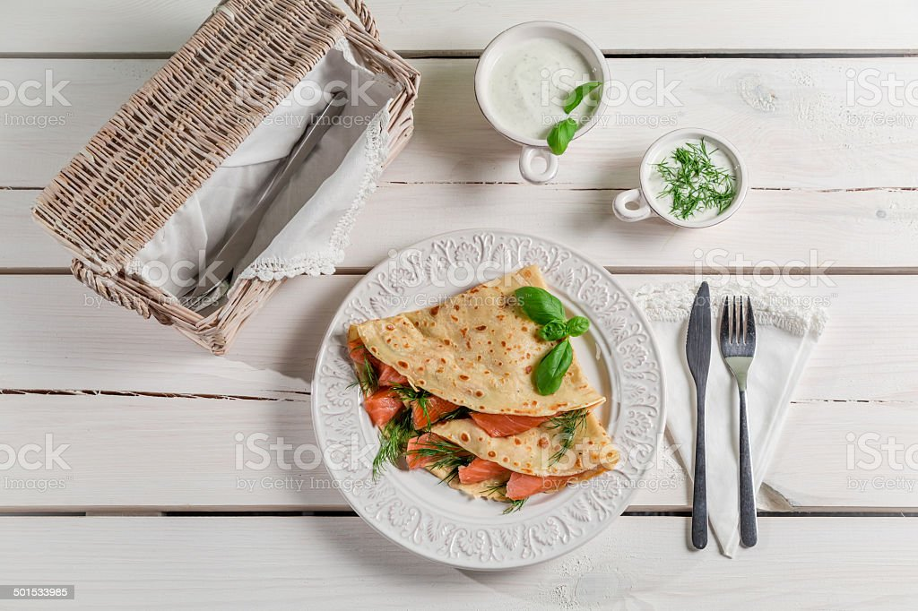 Pancake with salmon, dill and cream stock photo