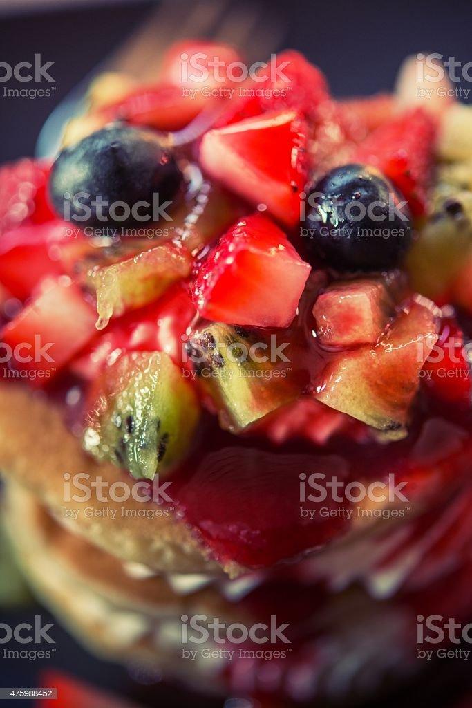 Pancakes, fruit, kiwi, strawberry berry sauce and strawberry. stock photo