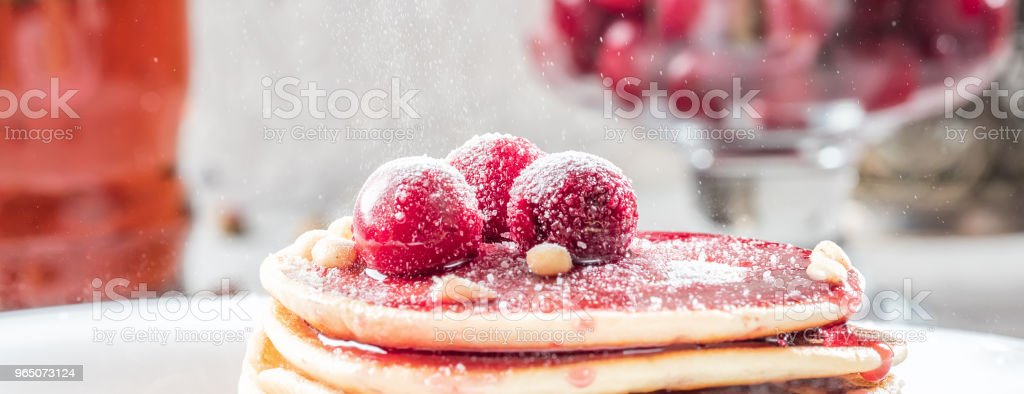 Pancakes homemade cake in stack decorated with berries frozen cherry Sprinkle with sugar powder on white plate zbiór zdjęć royalty-free