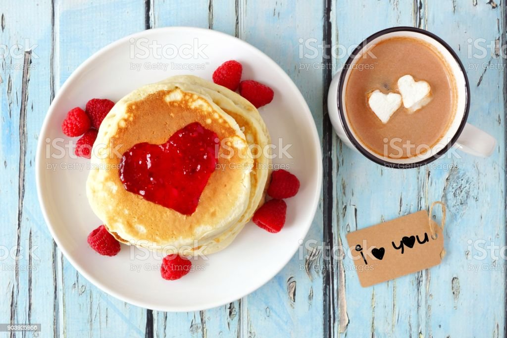 Pancakes, hot chocolate and I Love You tag over blue wood stock photo