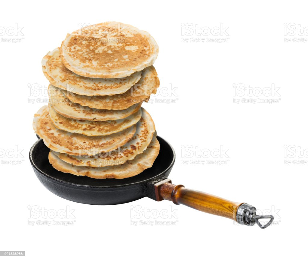 pancakes in a frying pan stock photo