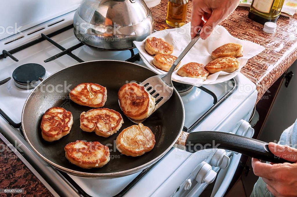 pancakes in frying pan stock photo