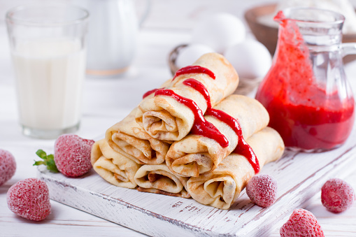 Pancakes stuffed with cottage cheese and berry sauce