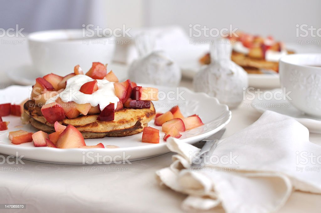 Pancakes with Apples compote and creme-fresh royalty-free stock photo