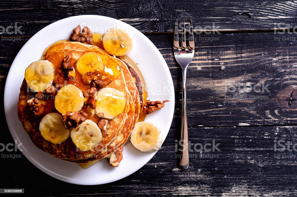 Pancakes with banana & walnut stock photo