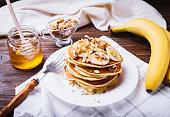 istock Pancakes with banana, walnuts and honey 937710936