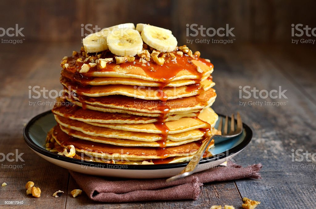 Pancakes with banana,walnut and caramel. stock photo