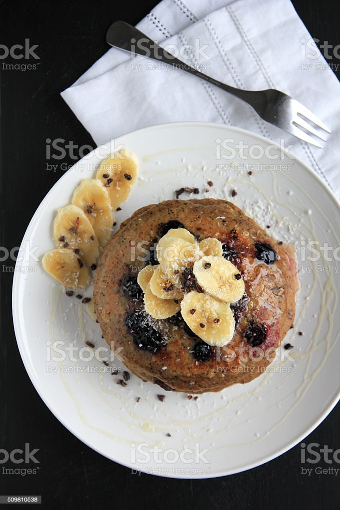 Pancakes with blackberries, banana and Maple syrup stock photo