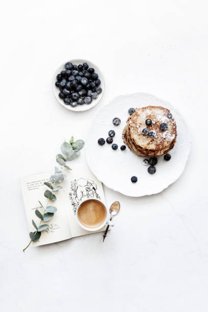 pancakes with blueberries and coffee - food styling stock photos and pictures