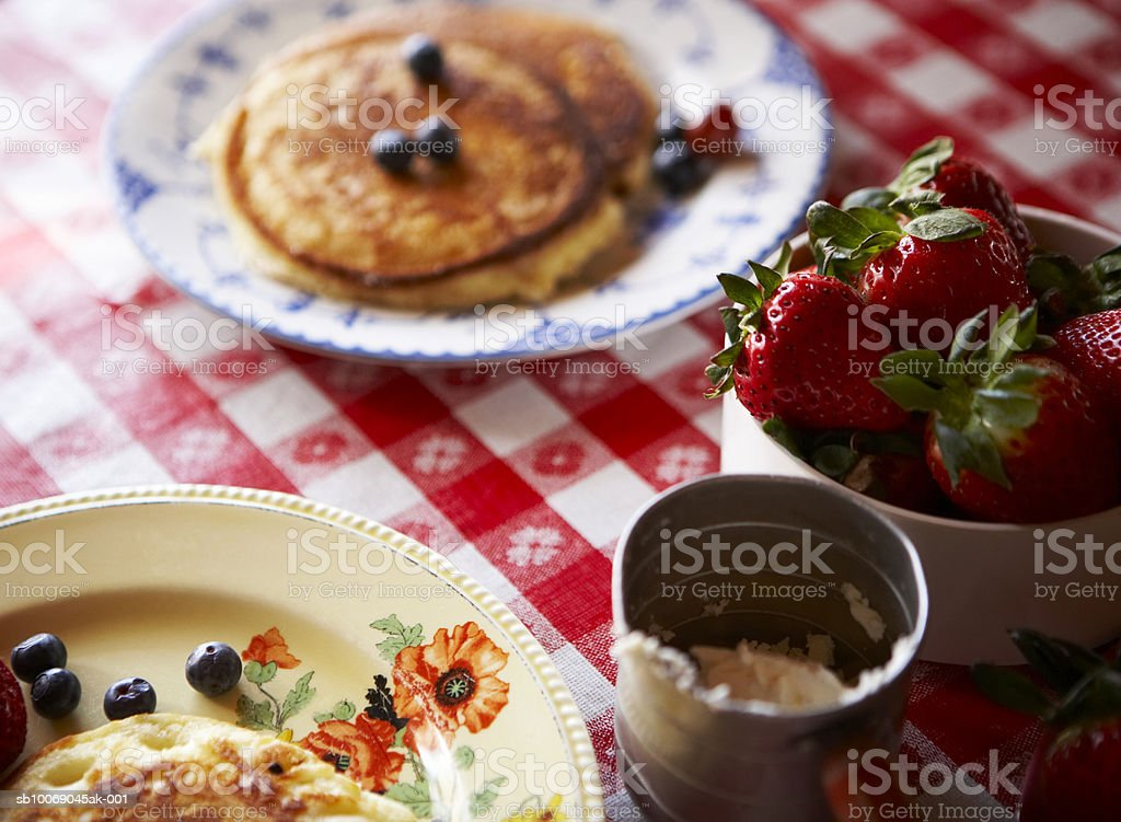 Pancakes with blueberries and strawberries, close-up royalty-free stock photo