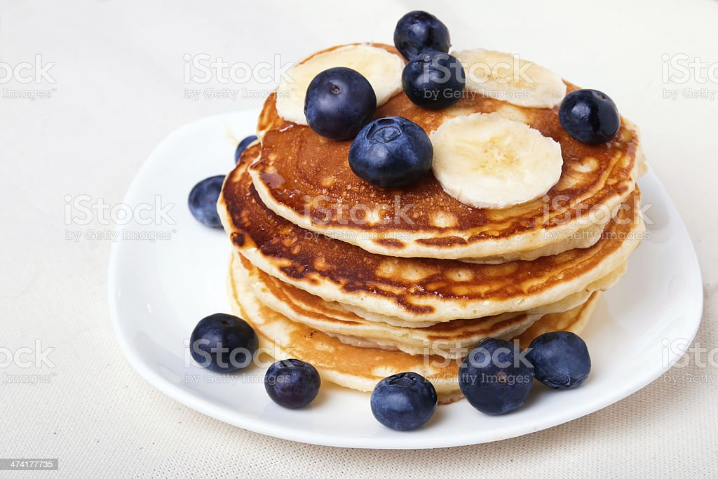 Pancakes with blueberry and bananas stock photo