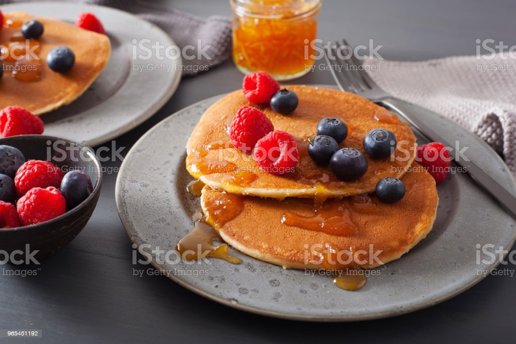 pancakes with blueberry raspberry honey and jam for breakfast royalty-free stock photo