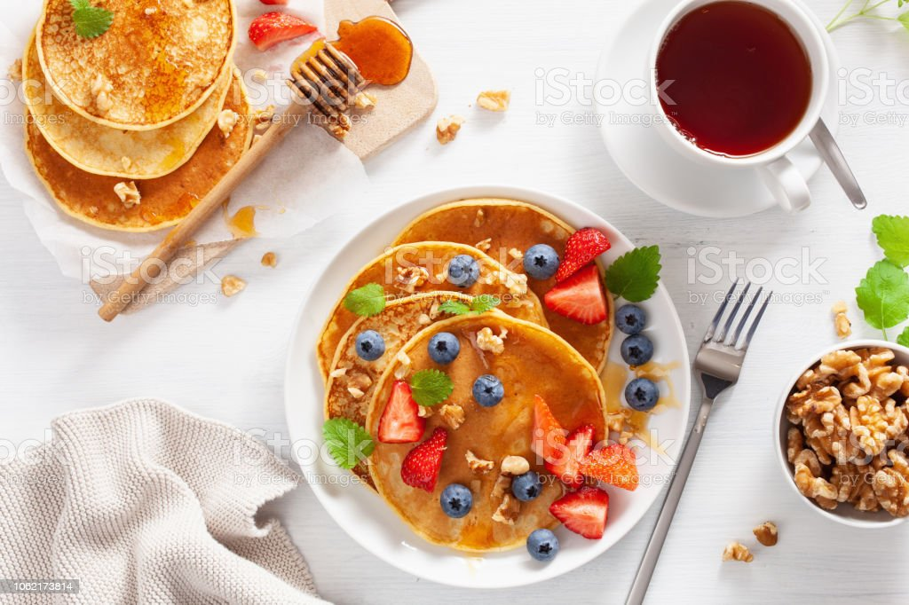 Pancakes With Blueberry Strawberry Honey And Nuts For