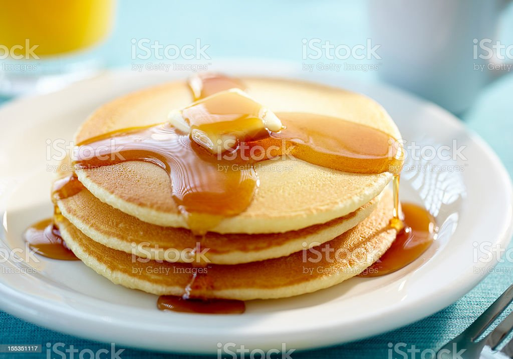 Pancakes with butter and syrup stock photo