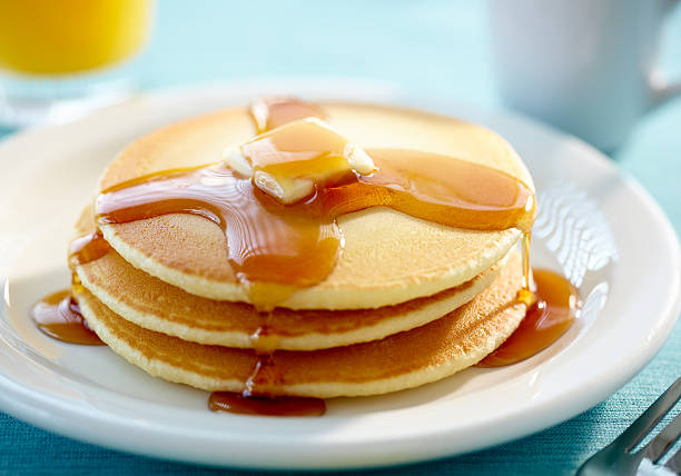 pancakes with butter and syrup - maple syrup stock photos and pictures