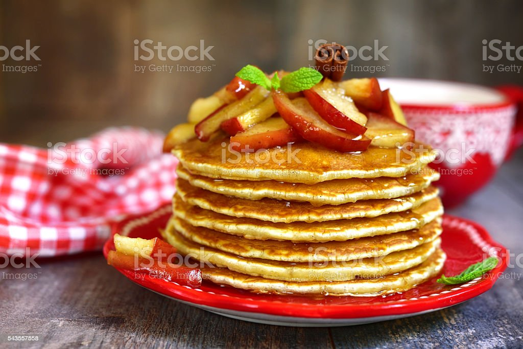 Pancakes with caramelized apple and cinnamon. stock photo