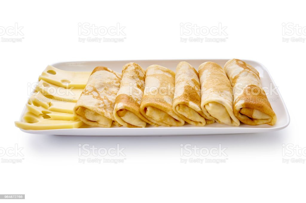pancakes with cheese are isolated on a white background royalty-free stock photo