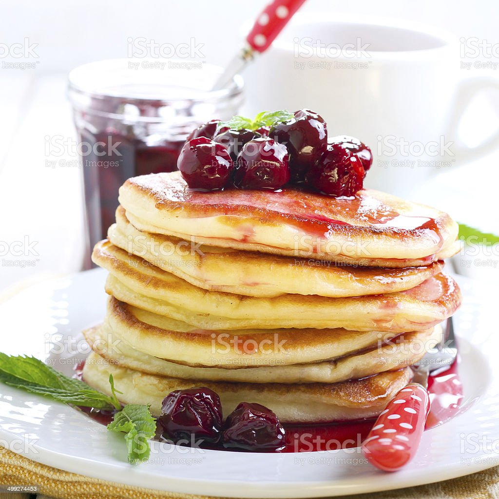 Pancakes with cherry sauce stock photo