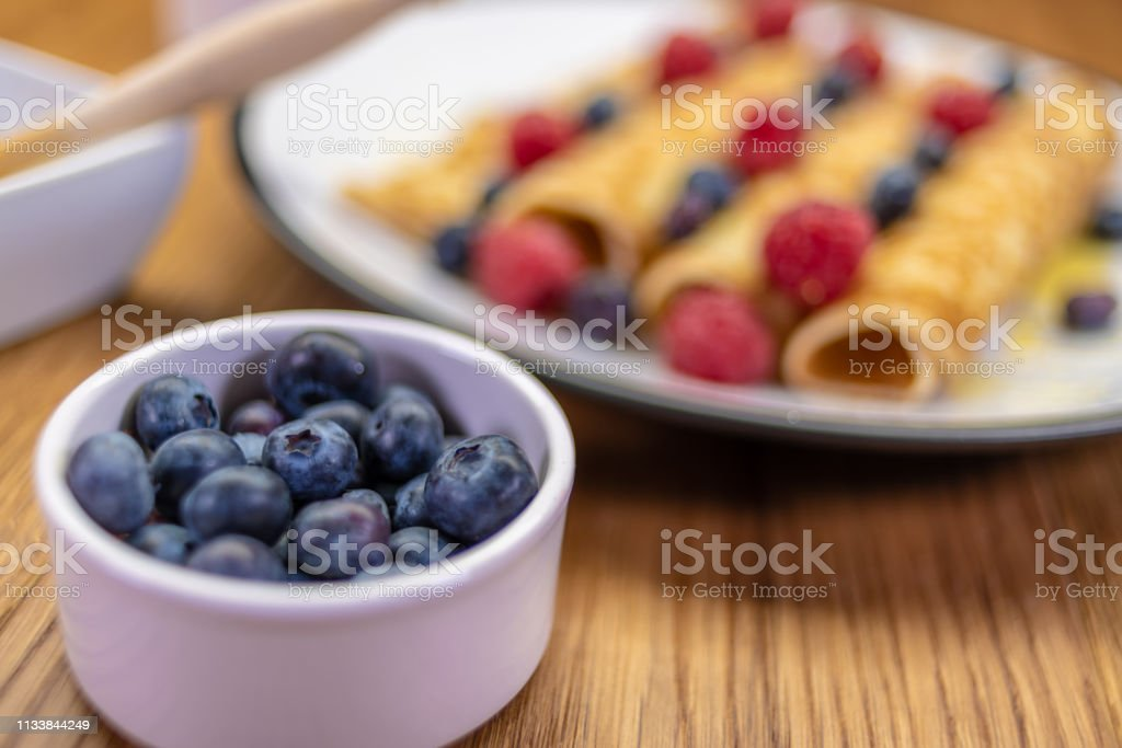 Pancakes with focus on blueberries stock photo