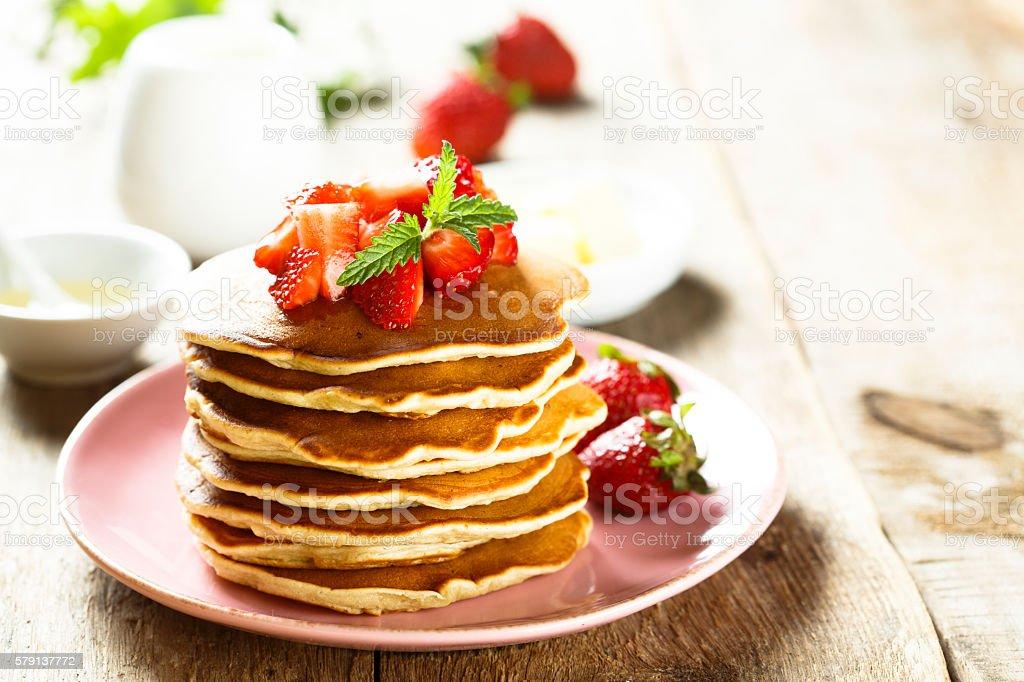 Pancakes with fresh strawberry stock photo