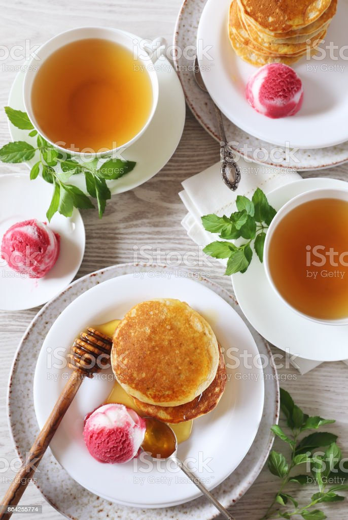 Pancakes with honey and fruit sorbet royalty-free stock photo