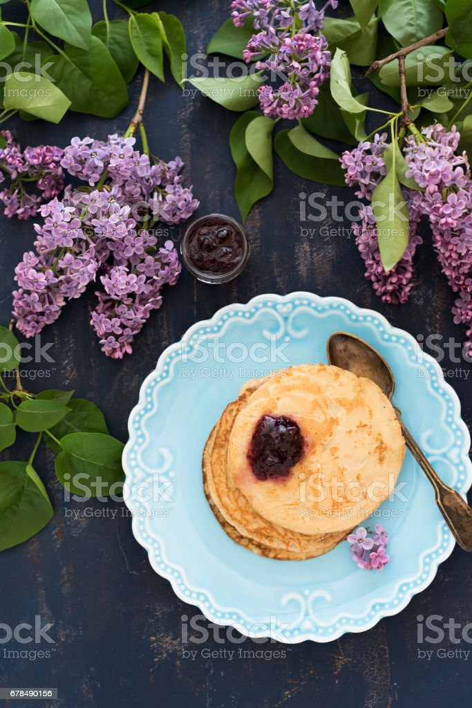 Pancakes with jam for breakfast stock photo